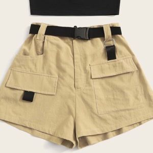 Beige cargo shorts with buckle belt.